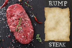 Beef steak on wooden table Royalty Free Stock Images