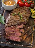 Beef steak on wooden table Royalty Free Stock Photos