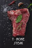 Beef steak on wooden table Royalty Free Stock Photo