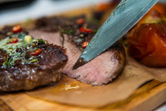 Beef steaks cut with knife Stock Photography