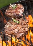 Beef steaks on grill Royalty Free Stock Images