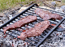 Beef steaks on the grill Stock Photo