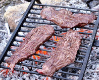 Beef steaks on the grill Stock Photography