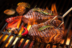 Beef steaks on the grill stock photos