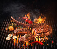 Beef steaks on the grill. With flames Stock Photo