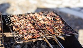 Beef steaks on the grill with flames Stock Photography