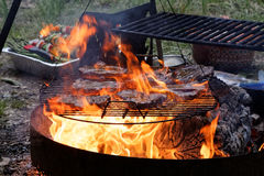 Beef Steaks on a Grill with Flames Royalty Free Stock Image