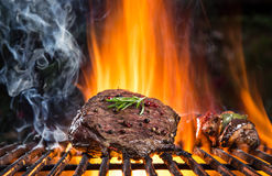 Beef steaks on the grill with flames Stock Photos