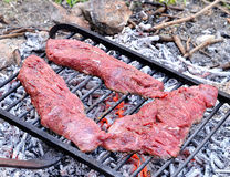 Beef steaks on the grill. Raw beef steaks on the grill for barbecue Royalty Free Stock Photos