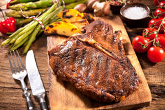 Beef steaks with grilled vegetables Royalty Free Stock Photo