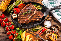 Beef steaks with grilled vegetables Royalty Free Stock Images