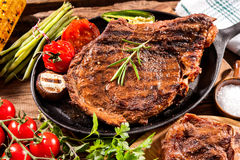 Beef steaks with grilled vegetables Royalty Free Stock Photography
