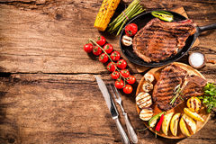 Beef steaks with grilled vegetables Stock Images