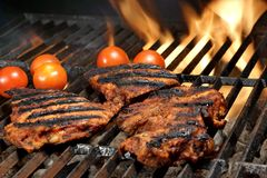 Beef Steaks On The Hot BBQ Grill With Bright Flames Stock Image