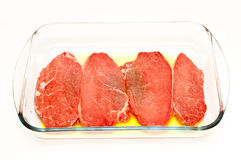 Beef steaks marinated in olive oil Stock Photo