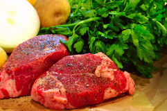 Beef steaks Stock Images