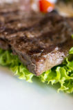 Beef steaks and salad Stock Photography