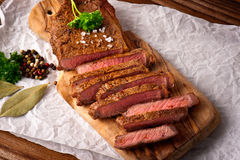 Beef steaks. Beef steak herbs and spices Stock Image