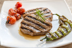 Beef steaks on the white square plate Stock Images