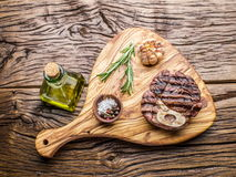 Beef steaks on a wooden tray. Stock Photo