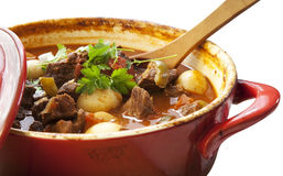 Beef Stew. In a red crock pot, ready to serve Royalty Free Stock Photo