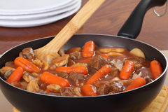 Beef Stew. With carrots and potatoes in a cooking pan Royalty Free Stock Photography
