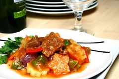 Beef stew. A serving of beef stew in tomato sauce stock photography