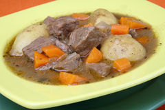 Beef stew with carrot and potato. On plate Royalty Free Stock Photography