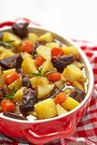 Beef stew in casserole dish Stock Photo
