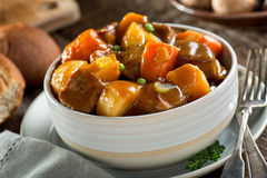 Beef Stew. A delicious bowl of rich and hearty beef stew with potato, turnip, carrot, celery, and peas Stock Image