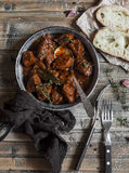 Beef stew in a frying pan on a wooden rustic table. royalty free stock photography
