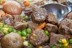 Beef Stew. Hearty and traditional beef stew close up, focus on the spoon Royalty Free Stock Image