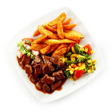 Beef stew with mixed vegetables and chips Royalty Free Stock Images