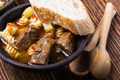 Beef stew with noodles and potatoes Royalty Free Stock Images