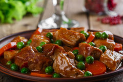 Beef stew. With peas and carrots on a plate Stock Images