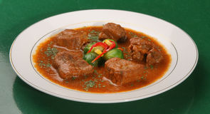 Beef stew. On the plate with spices Royalty Free Stock Photography