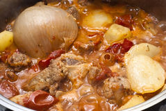 Beef stew in the pot. Beef stew, potatoes and onion in the pot Stock Photo