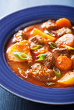 Beef stew with potato and carrot in blue plate Royalty Free Stock Photography