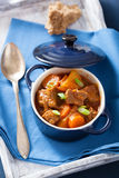 Beef stew with potato and carrot in blue pot Royalty Free Stock Photography