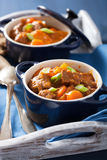 Beef stew with potato and carrot in blue pots Stock Images