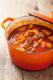 Beef stew with potato and carrot in red casserole Royalty Free Stock Image