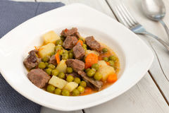 Beef stew with potatoes, carrot and green beans Stock Image