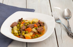 Beef stew with potatoes, carrot and green beans Stock Photo