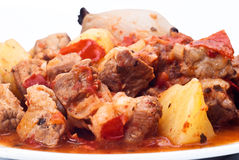 Beef stew, potatoes and onion. On white background Royalty Free Stock Photography