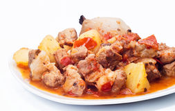 Beef stew, potatoes and onion. On white background Royalty Free Stock Image