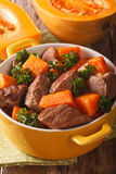 Beef stew with pumpkin macro in a pot. vertical Royalty Free Stock Photography