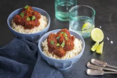Beef stew on rice. Two bowls of homemade Beef stew served on rice with capsicum and coriander royalty free stock photos