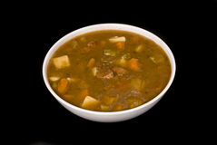 Beef stew soup on black background Royalty Free Stock Images