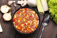 Beef stew soup on a wooden background Stock Photography