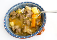 Beef stew in a spoon Royalty Free Stock Images